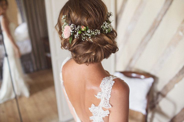 Boho hairstyle with fresh flowers